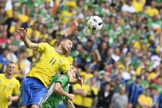 Sweden's forward Marcus Berg (L) vies for the ball with Ireland's midfielder Robert Brady during the Euro 2016 group E football match between Ireland and Sweden at the Stade de France stadium in Saint-Denis, near Paris, on June 13, 2016. / AFP / JONATHAN NACKSTRAND