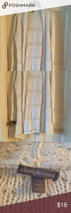Charlotte Russe long sweater Charlotte Russe long sweater winter white very cute. Sweater is long and  goes past butt great condition I wear size 2 Charlotte Russe Sweaters Cardigans