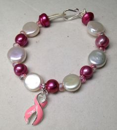 A personal favorite from my Etsy shop https://www.etsy.com/listing/248611235/breast-cancer-awareness-freshwater-coin