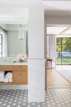 Linc Sconce by The Urban Electric Co. #bathroomdecor #masterbath #carraramarbletile #floatingvanity #sconceonmirror #hextile #hexagonaltile #steelframedoor #spabathroom #spabath #bathroomideas