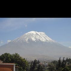 Arequipa, Peru. Enjoying a cup of coffee, sitting in a mirador with a breathtaking view on El Místi.