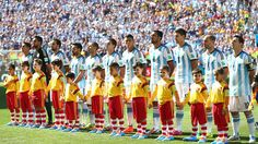 Before the start of the match the players on each team walk on the field to stand in line and sing the national anthem.