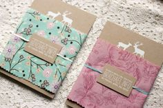 Designer Rachael Ward decided to combine kraft paper, white ink screen printing, and fabric for her woodland wedding invitations.  So pretty!