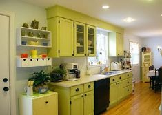 Interesting example of green with light wood flooring.  But I'm seeing that green is so popular right now, I might want to move away from it; I think it will look dated quick.  White or yellow will be more classic, I think.