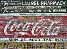 I wish I could take this wall and put it in my house. If only there were a way. Look at all that chippy wear and tear on the Coca-Cola portion!