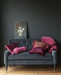 Charcoal velvet sofa with plum pink cushions