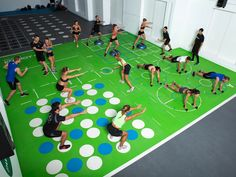 Fitness facility with interlocking high density rubber flooring and zone markings.