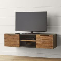 "Shop Rigby 55"" Small Floating Media Console.   Rich with the texture of rustic teak, the Rigby media console is framed in matte black for a contemporary look."