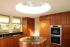 Round skylight over kitchen island | Kitchen Remodel | Los Gatos, San Francisco Bay Area, California  Award winning mid-century home remodeling project
