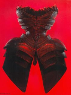 """thierrymugler:    Carapace of sculpted leather, stamped and fringed with black feathers.  """"Les Insectes"""" Couture collection, S/S 1997  Thierry Mugler: Galaxy Glamour        An armor as a corset.. or the other way round?"""