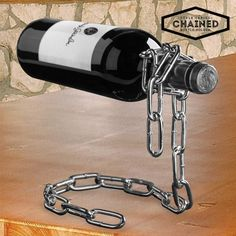 If you're a wine lover and like to give wine accessories pride of place in your home, you won't be able to resist the design of this Summum Sommelier chained bottle holder. This wine bottle holder is practical and functional and will give a touch . Welding Art Projects, Metal Art Projects, Metal Crafts, Liquor Dispenser, Metal Welding, Scrap Metal Art, Wine Bottle Holders, Metal Furniture, Wine Rack
