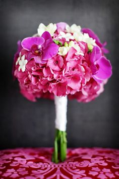 Bridesmaids: 3 Pink Orchids with pink Hydrangeas (no white).  green ribbon to match stems with long streamers.
