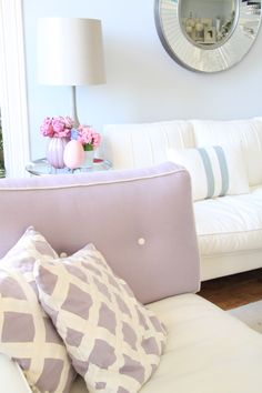 my living room, bright airy, grey walls, pink details, white sofa