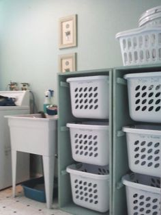 What a neat idea for the laundry room. I always love ways to go vertical and get things off the floor!