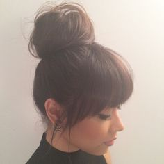 Quick and easy topknot with perfect soft face framing fringe. #SexyHair #Topknot #EasyHairstyles