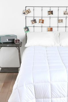 $79 Urban Outfitters Memento Headboard that doesn't have to be a headboard.  Cool alternative to a bulletin board in an office!