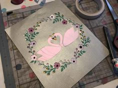Layered swan papercut for Valentine's Day from a pattern in Mollie Makes magazine