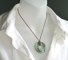 Necklace made from a washer, scrapbook paper, and mod podge.