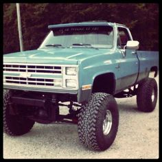 nice work on a vintage Chevy truck - lifted - painted an interesting color... haha see, I can like some chevys lol