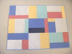 Crib T shirt quilt in pastel colors by TShirtsRenewed on Etsy