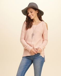Sweater, chunky silver necklace, faded jeans