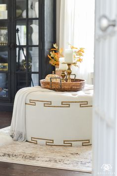 2017 Fall Home Tour with Yellow and Orange Leaves- greek key ottoman