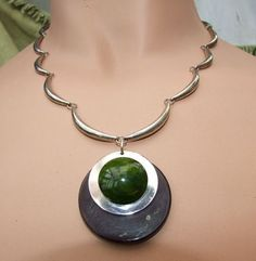 Beautiful Art Deco Scalloped Circle Necklace by JAKOB BENGEL.  Marbled black and green galalith pendant necklace with chrome scalloped chain.
