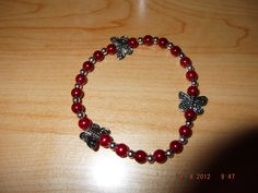3 Butterfiles with Ruby Red Beads with Silver Balls $13.00 includes shipping cost call 517 203-6260