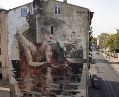 regram @powwowworldwide New mural by Borondo in Lodz Poland. // Found via @streetartnews.