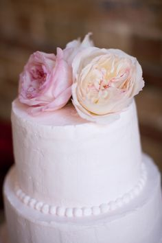 Pale Pink Wedding Cake With Flower Topper