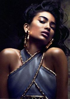 Kelly Gale wears Balmain Fall/Winter 2014 earrings and top for VOGUE India.