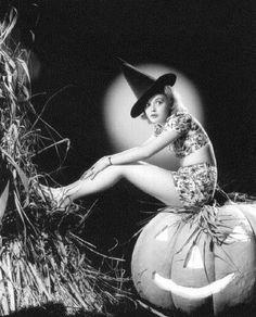Nancy Grey and a hat on a big pumpkin, no broom...