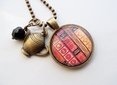 This necklace features a picture of antique book spines. It is the perfect gift for the book lover, librarian, writer or teacher in you life. It