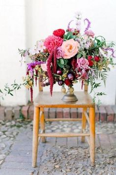 spectacular floral centrepiece in a large goblet, with pinks, reds, purple and green. Really wows!