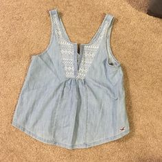 NWT blue tank top NWT hollister tank! It is super pretty white white denim for spring and summer Hollister Tops Tank Tops