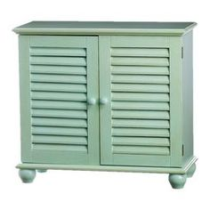 """Finished in light blue and showcasing louvered doors and turned bun feet, this wood end table adds a pop of coastal style to your living room or bedroom.       Product: CabinetConstruction Material: Engineered woodColor: Light blueFeatures:  Two louvered doorsTurned bun feetDimensions: 32"""" H x 13"""" W x 29"""" D"""