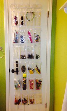 Limited bathroom storage solution !! LOVE! a.k.a. 2 tween girls + 2 bathroom doors & their own hangers= FABULOUS! Works like a dream.