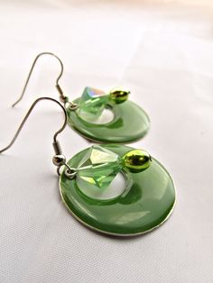 Handmade Green enameled earrings with crystal and metallic glass bead. The earrings has a 1 inch drop. I really like the different design shapes