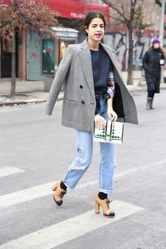 Love her outfit; love her style; and especially love the clutch...her shoes ... and the jacket...OK, everything.