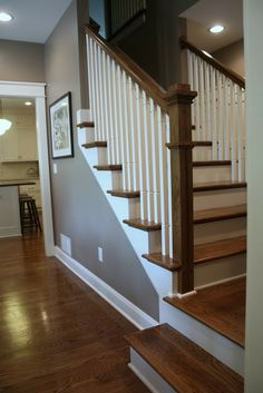 Love the clean look of these stairs… painted posts white.