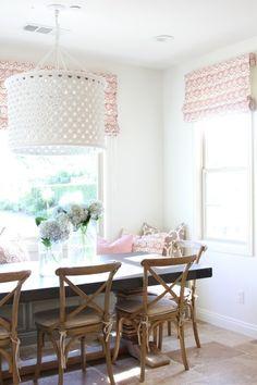 Cozy nook: http://www.stylemepretty.com/living/2015/04/15/a-sunny-kitchen-nook-makeover/ | Design: Becki Owens - http://beckiowens.com/