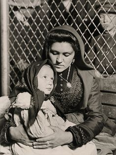 Italian immigrant Italian mother and child after arriving in Ellis Island. (Photo courtesy of Preus Museum.), traditional American specialties called 'spaghetti with meatballs,'