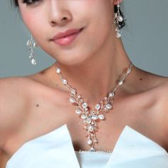 White Swarovski Pearl Y Shape Vine Bridal Set - via Etsy.