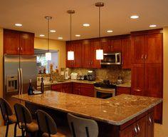 kitchen cherry cabinets, light floor - grey/brown granite