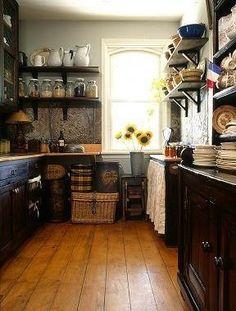 small kitchen idea - very vintage-y with the dark color scheme