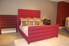Bassett's raspberry upholstered bed -