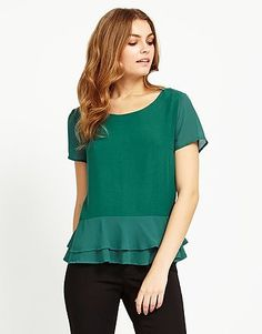 Dark green short sleeve blouse with veil ruffles on the bottom. Trendy look with simple jeans and nice heels Polyester, Viscose. Short Sleeve Blouse, Short Sleeves, Uk Brands, Green Shorts, Green Fashion, Lipsy, Latest Trends, Women Wear, Tunic Tops