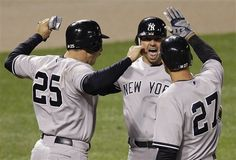 GAME 6: Wednesday, April 11, 2012 - New York Yankees' Nick Swisher, center, meets Mark Teixeira (25) and Raul Ibanez at home plate after scoring Teixeira with a home run in the 10th inning of a baseball game against the Baltimore Orioles in Baltimore. New York won 6-4 in 10 innings. (AP Photo/Patrick Semansky)