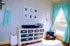 Navy and Teal Nautical Nursery - what a fab paint job on the vintage dresser!