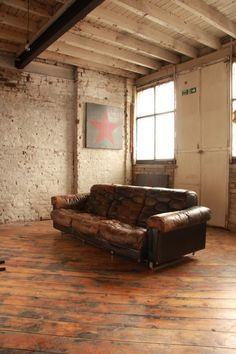leather couch, great wood floor
